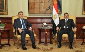 انتهاء القمة الثلاثية بين مرسى وجول ونجاد