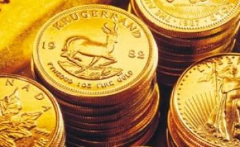 الذهب يتجاوز 1590 دولارا متجها للصعود