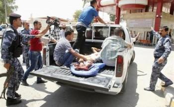 الشرطة: مقتل 14 شخصا في ثلاثة تفجيرات بالعراق