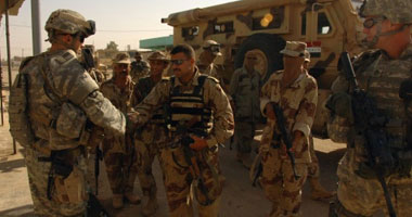 قوات عراقية تابعة للفوج الرئاسى تحاصر أحد مقار الحشد الشعبى وسط بغداد